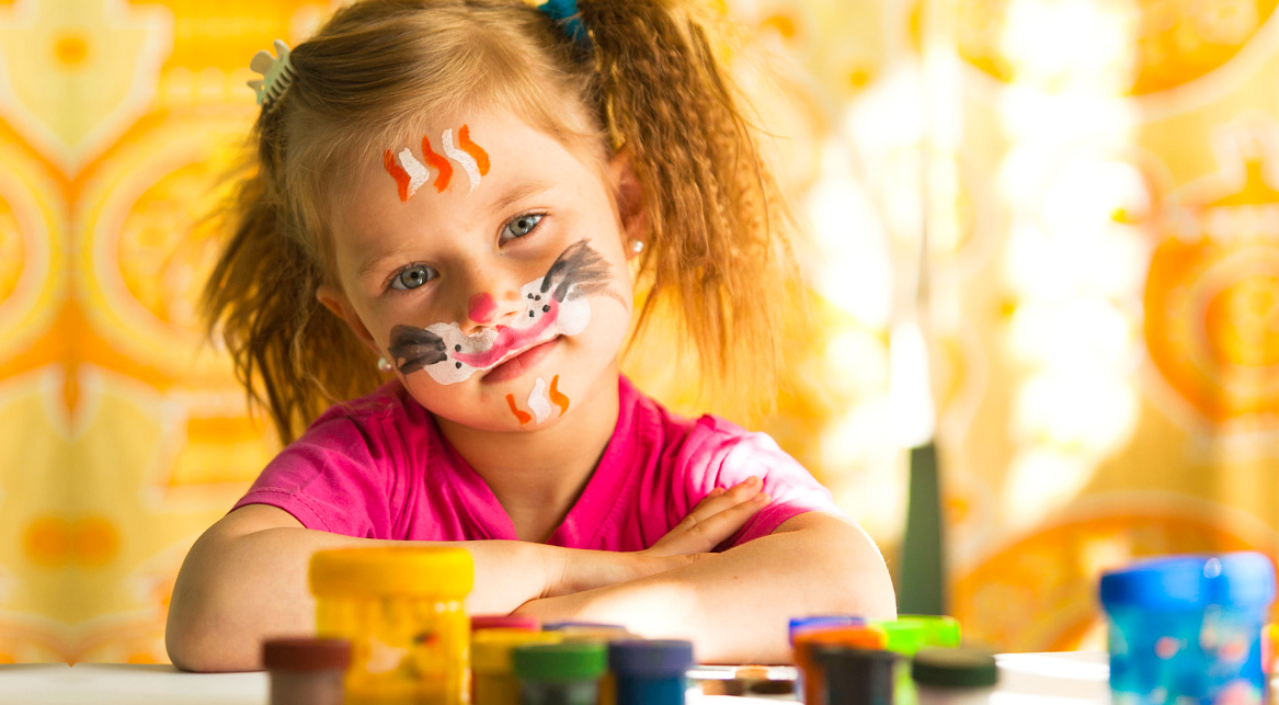 little girl with paint in her face